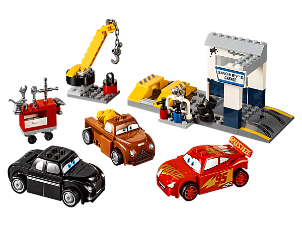 Help repair Disney•Pixar's Lightning McQueen, featuring a garage with ramps, movable crane, spare tires and assorted tools. Includes 3 Easy to Build LEGO® Juniors cars.