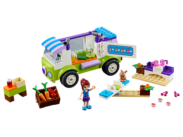 Buy fresh fruits and veggies from Mia's Organic Food Market, featuring an Easy to Build truck with Quick Start chassis, merry-go-round, picnic table, mini-doll figure and bunny figure.