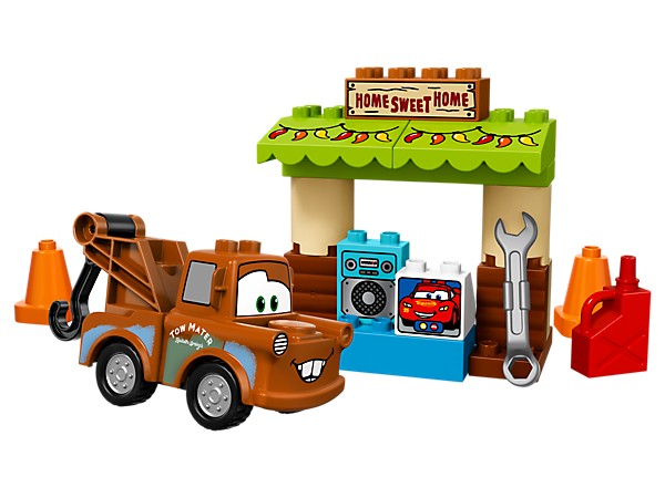 Your child will love playing at making video calls in Disney•Pixar Mater's shed with decorated awning, computer decorated brick and a buildable Mater with hook.