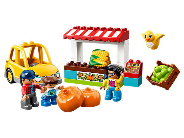Learn about how to shop from a market stall while looking at all the produce on offer at the LEGO® DUPLO® Farmers' Market, with 3 DUPLO figures and a buildable car.