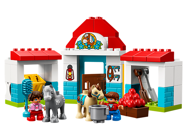 Toddlers will love to groom, feed and water the cute pony figures at the LEGO® DUPLO® Farm Pony Stable, developing fine motor skills as they build this colorful set.