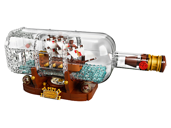 Build and display the LEGO® Ideas Ship in a Bottle, featuring a brick-built bottle with buildable cork, highly detailed ship and display stand with nameplate and compass with spinning needle.
