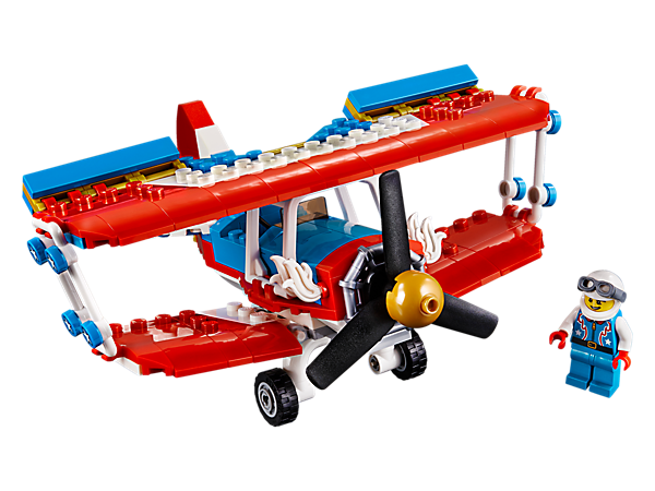 Amaze your friends with the 3-in-1 Daredevil Stunt Plane set, featuring a colorful biplane with stars and golden detailing. Rebuilds into a Rocket Car or a Rocket Boat. Includes a minifigure.