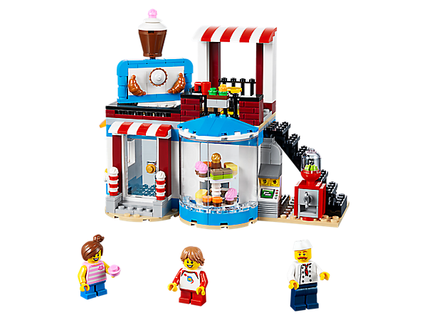 Serve sweet-toothed minifigures with this 3in1 Modular Sweet Surprises set, featuring a cozy cake shop with a roof terrace and vending stand. Rebuilds into a Pool House or a Food Corner Café.