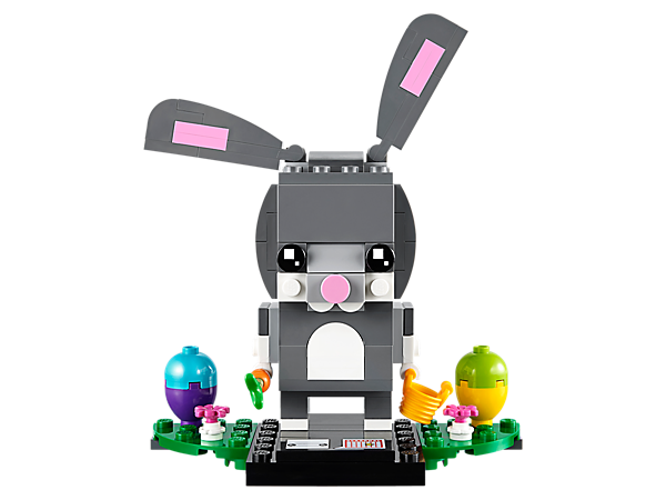 Hunt the eggs with this LEGO® BrickHeadz™ Easter Bunny, featuring movable ears, a bucket, carrot, flowers, Easter eggs and a buildable collector's baseplate.