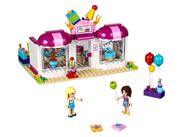 <p>Pick up party supplies at the Heartlake Party Shop with an opening door, turning carousel, removable display stands, lots of party accessory elements and 2 mini-dolls.</p>