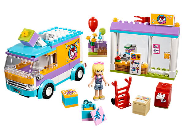 Take orders for gifts or flowers at the shop with gift stand and cash register, then load them into the van to deliver them with Sephanie. Includes a mini-doll figure.