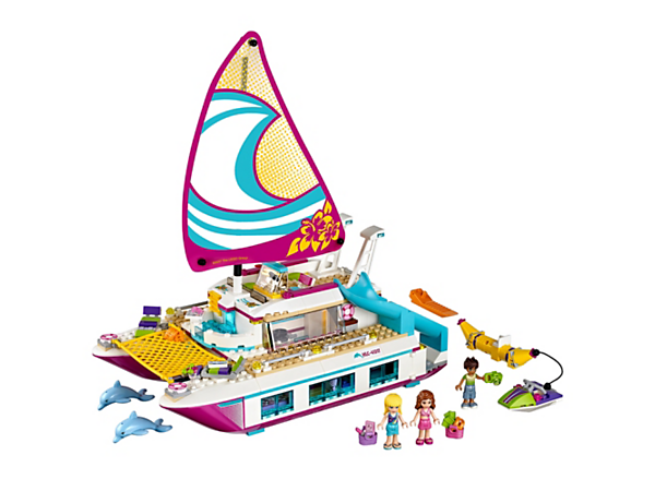 Cruise on the Sunshine Catamaran with a sun deck, pool, bridge, slide, living quarters, personal water scooter, banana boat, 2 dolphin figures and 3 mini-doll figures.