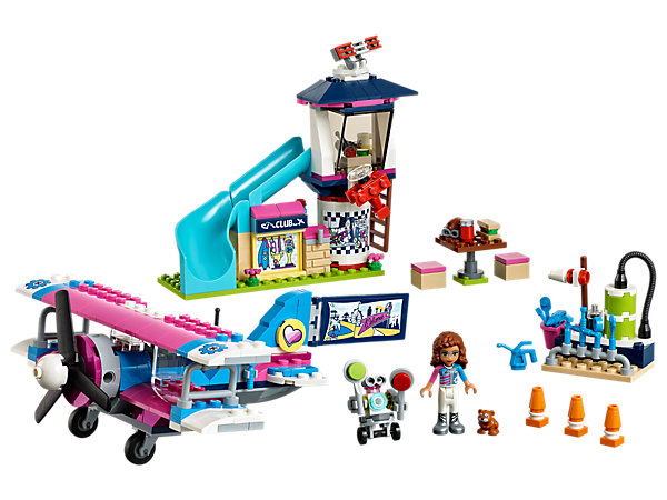 Go on a LEGO® Friends Heartlake City Airplane Tour with Olivia in this propeller plane with an air traffic control tower, a snack table with bar stools and a refueling station.