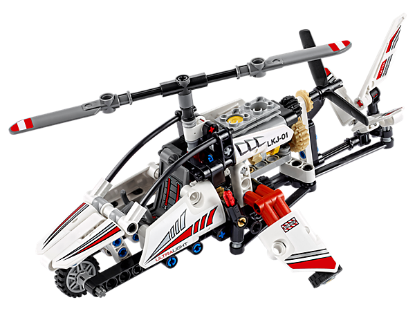 Lift off in style with the 2-in-1 LEGO® Technic Ultralight Helicopter, featuring spinning rotors, working rudder, detailed engine with moving pistons, and a white, red and black color scheme.