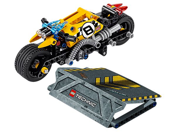 Thrill the crowds with the amazing LEGO® Technic Stunt Bike, featuring a high-speed pull-back motor, huge tires, cool exhaust, yellow and black color scheme and a buildable stunt ramp.