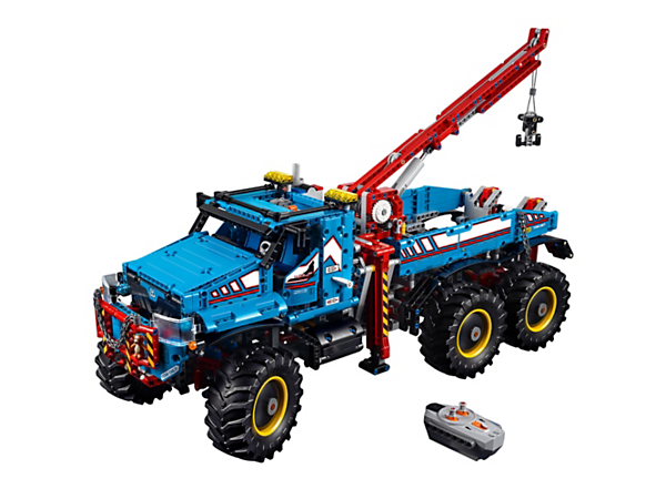 Take control of the LEGO® Technic 6x6 All Terrain Tow Truck, with remote-controlled forward and reverse drive, steering, outriggers, crane and winch, plus opening doors and movable lights.