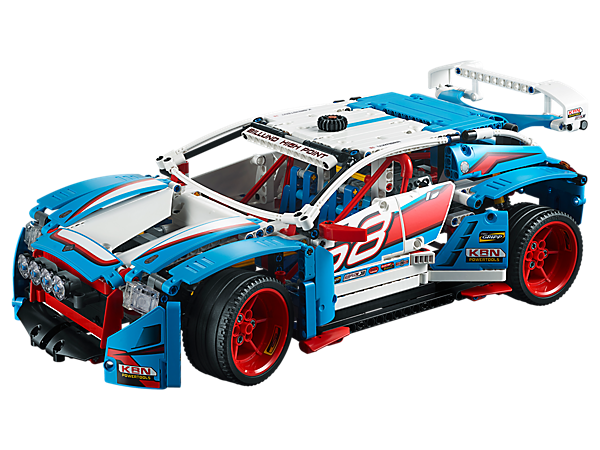 Build your own LEGO® Technic Rally Car with large rear spoiler, 6-spoke red rims with low-profile tires, detailed cockpit with roll cage, V6 engine with moving pistons, and working steering and suspension.