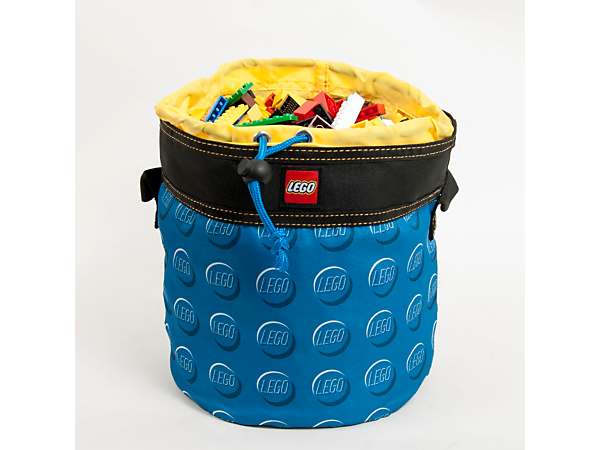 Organize, store and transport your stuff in the LEGO® Blue Cinch Bucket with a cinch closure, sturdy carry handle and transparent, water-resistant EVA plastic base.