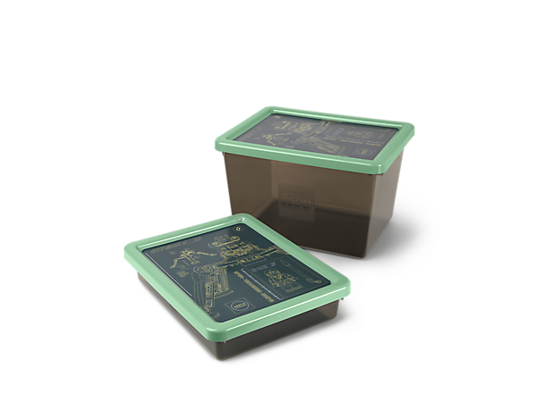 Organize your toys and save space with this stackable, see-through plastic THE LEGO® NINJAGO® MOVIE™ Small Storage Box, featuring NINJAGO graphics on the lid.