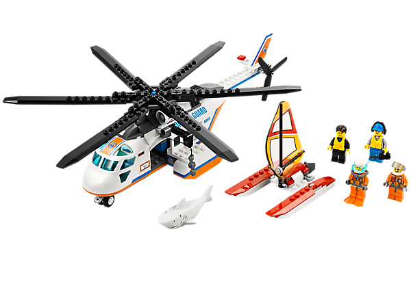 Fly to the rescue with the LEGO® City Coast Guard Helicopter with working winch, catamaran sailboat, 4 minifigures and a great white shark!
