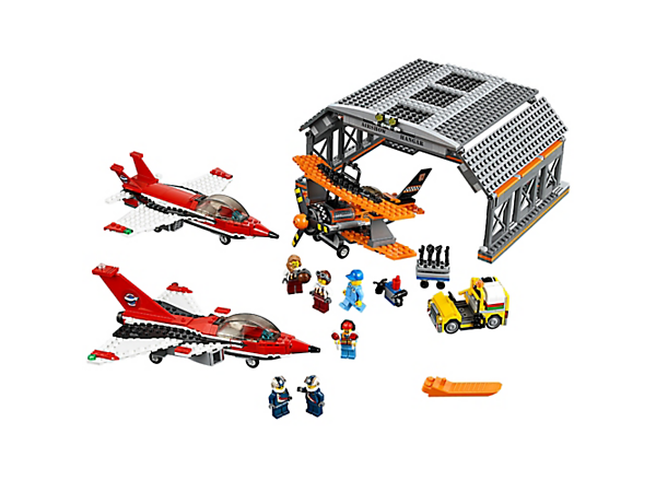 <p>Fly high at the Airport Air Show with 2 jets and an old-fashioned plane with spinning propeller. Includes 6 minifigures, hangar, airport service car and a tool wagon.</p>