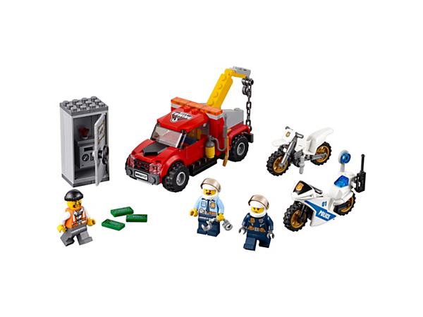 Chase down the crook in the tow truck with the police off-road bike and police pursuit bike, featuring a radio, lollypop stop sign and safe, plus three minifigures.