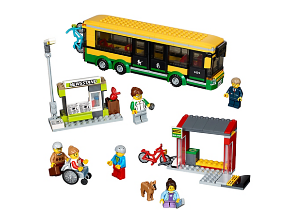 Catch a ride downtown on the LEGO® City Bus, featuring opening front and side doors, wheelchair access, a bus stop and newsstand, plus 6 minifigures and a dog figure.