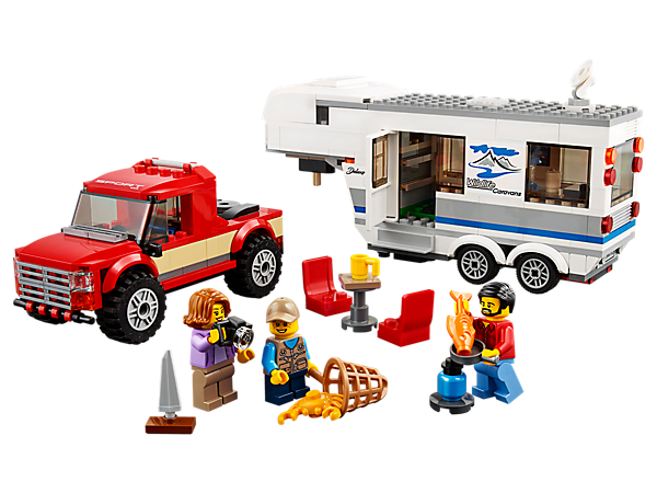 Get ready for a fun family vacation with the Pickup & Caravan, featuring a pickup truck and detachable caravan with opening side and removable roof, plus 3 minifigures and a crab figure.
