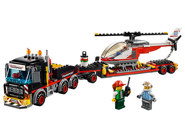 <p>Climb into the cab of the Heavy Cargo Transport and get hauling! Features a heavy truck with opening cab, toolbox and trailer, plus a helicopter with spinning rotors, chain and 2 minifigures.</p>