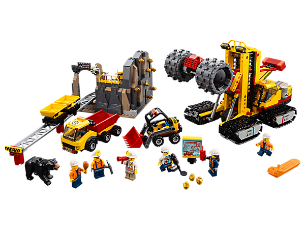 Dig for treasure at the LEGO® City Mining Experts Site, including a grinder/crusher, mine with track system, front loader, dump truck, mobile lab, 6 minifigures, and bear and spider figures.
