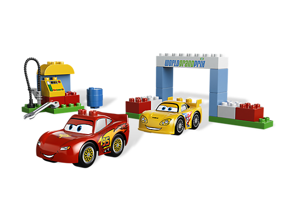 Race Lightning McQueen and Corvette from Disney/Pixar Cars™ in the World Grand Prix with a pit stop for repairs and LEGO® DUPLO® bricks!