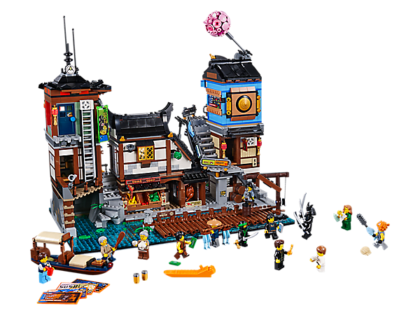 Explore NINJAGO® City Docks with a harbor, crane, grocery store with food-display-tipping function, house, dojo, workshop, tearoom, arcade, functioning vending machine and 13 minifigures.