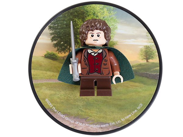 Collect and display the authentic hobbit minifigure, Frodo Baggins™, including Sting™, attached to a decorated backplate and magnet!