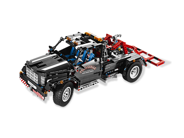 Build this massive 954 piece American-style Pick-up Tow Truck with realistic functions for a 2-in-1 tribute to a classic cultural icon!